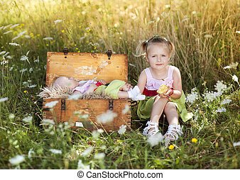 Cute little girl with baby sister