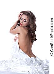 Sensual woman posing naked, hiding behind sheet - Image of...