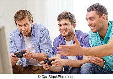 smiling friends playing video games at home