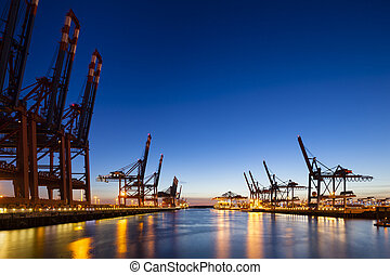 Container Terminals at Night - A large container harbor with...
