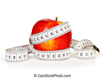 apple and tape measure isolated on white