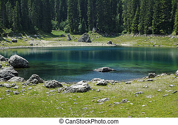 Karersee lake of Carezza - Lake of Carezza Karersee,...
