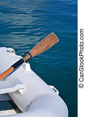 Dinghy boat - White dingy boat with wooden oar mooring at...