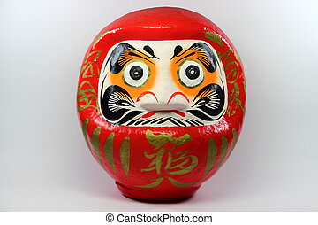 Daruma doll - Traditional symbol of Buddhism, present as...