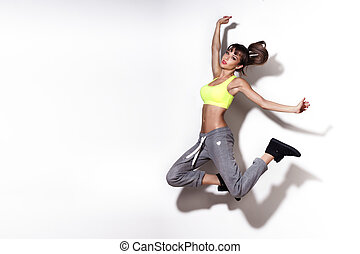 Attractive sensual woman jumping
