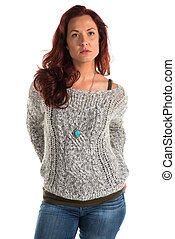 Redhead - Pretty redheaded woman in a gray sweater and jeans