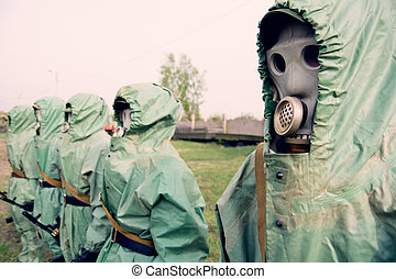 Soldiers in their masks and protective clothing.