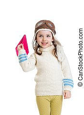 little girl dressed as pilot and playing with paper airplane isolated on white background