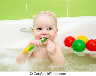 baby boy brushing teeth in bathroom