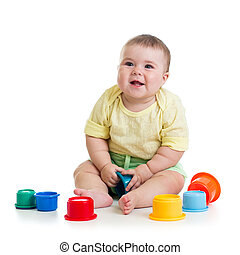 baby girl playing with toys isolated on white