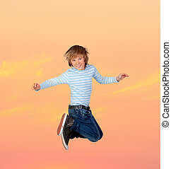 Adorable preteen boy jumping