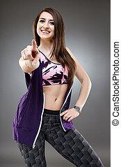 Sporty girl - Portrait of a sporty girl in sportswear outfit...