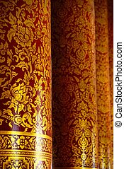 golden pillars - the detail of thai style gold painting on...