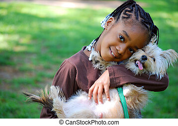 Little girl holding dog - Little girl hugging her dog