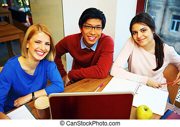 Happy Group Of Young Students Studying Together