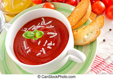 Tomato soup with cheese and basil