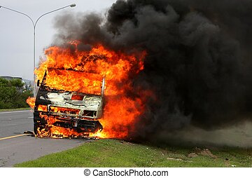 Motor Vehicle Inferno - Delivery vehicle ablaze on the side...