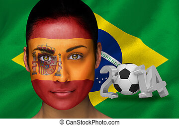 Composite image of spanish football fan in face paint...