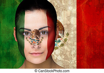 Composite image of beautiful football fan in face paint...