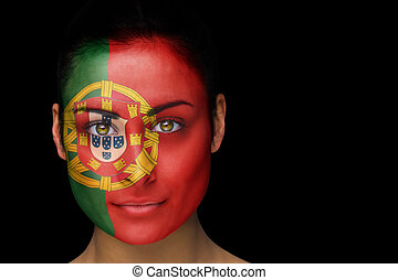 Portugal football fan in face paint - Composite image of...
