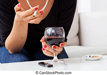 Woman with addictions - Woman is smoking cigarette and...