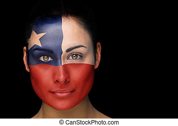 Composite image of chile football fan in face paint against...