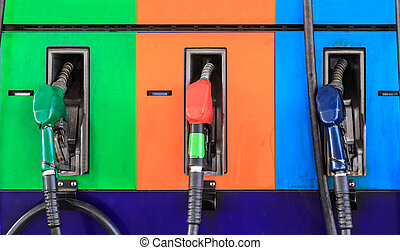 Gas pump nozzles in a service station - Gas pump nozzles in...