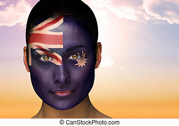 Composite image of beautiful brunette in australia facepaint...