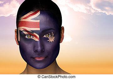 Composite image of beautiful brunette in australia facepaint...