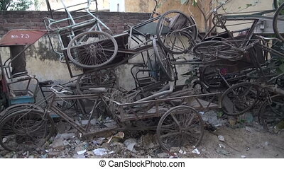 old broken rickshaw bicycle for recycling and restoration in...