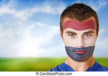 Composite image of netherlands football fan in face paint...