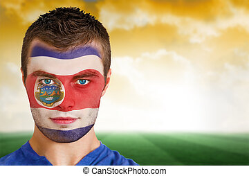Composite image of costa rica football fan in face paint