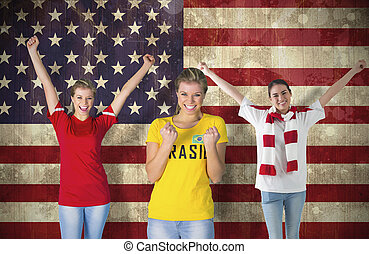 Composite image of various football fans against usa flag in...