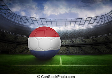 Football in holland colours in large football stadium with...