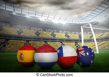 Composite image of footballs in group b colours for world...
