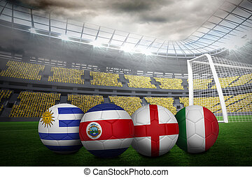 Composite image of footballs in group d colours for world...