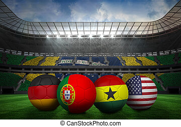 Composite image of footballs in group g colours for world...