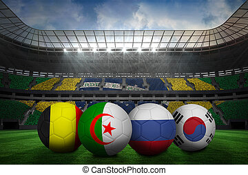 Composite image of footballs in group h colours for world...