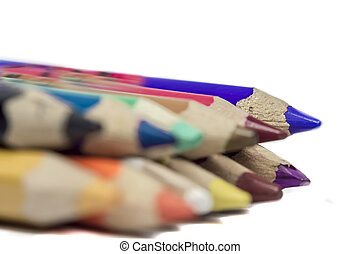 Pencil colors arranged on white background