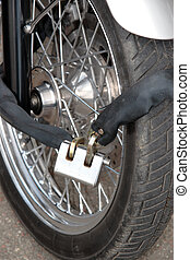 secure motorbike wheel - a secure motorbike wheel with a...