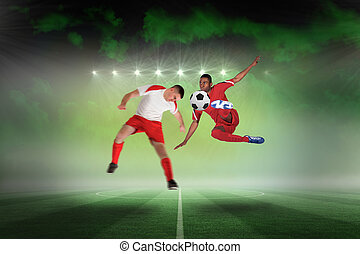 Composite image of football players tackling for the ball -...