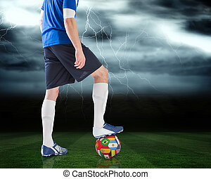Football player standing with inter - Composite image of...