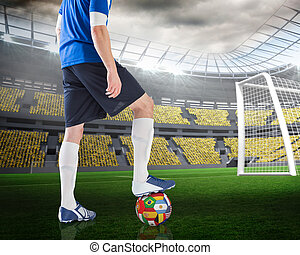 Composite image of football player standing with...