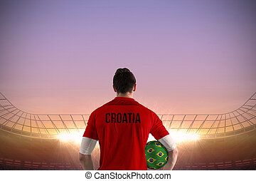 Composite image of croatia football player holding ball -...