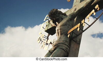 Crucifixion Christian cross with Jesus Christ statue over...