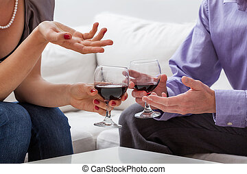 Copule with vine - Man and woman are drinking red vine