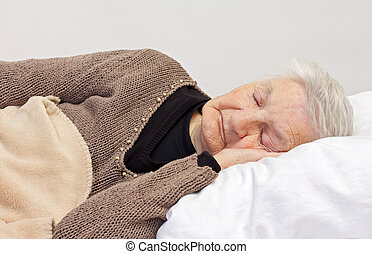 Let's be well - Elderly wrinkled woman laying in the bed