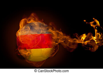 Composite image of fire surrounding germany ball against...