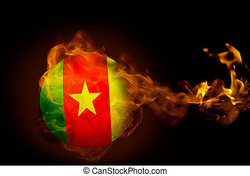 Composite image of fire surrounding cameroon ball against...
