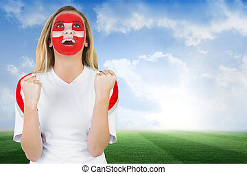 Excited fan in swiss face paint che